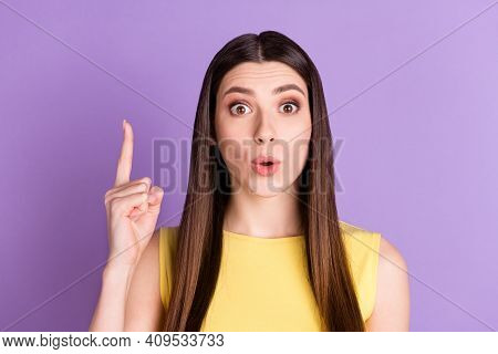 Portrait Of Attractive Amazed Brainy Girl Pointing Forefinger Up Copy Space Isolated Over Violet Pur