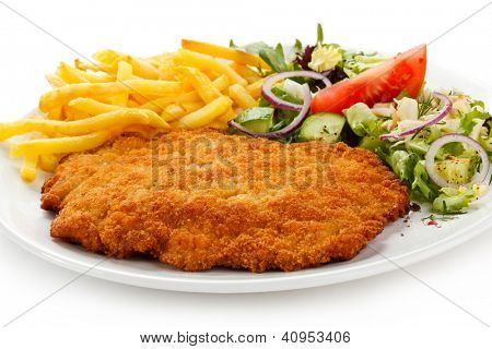 Fried pork chop French fries and vegetables