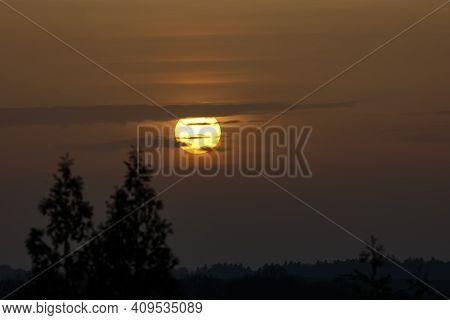 Beautiful Sunset - Setting Sun In The Clouds