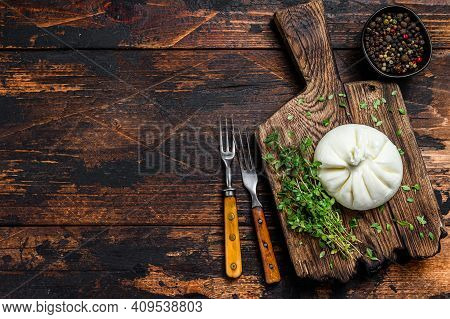 Italian Fresh Cheese Burrata On A Wooden Cutting Board. Dark Wooden Background. Top View. Copy Space