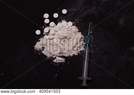 International Day Against Drug Abuse And Illicit Drug Trafficking Images. Drugs On A Black Backgroun