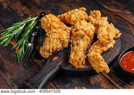 Breaded Chicken Drumstick, Leg, Wing And Breast Tenders Strips. Dark Wooden Background. Top View