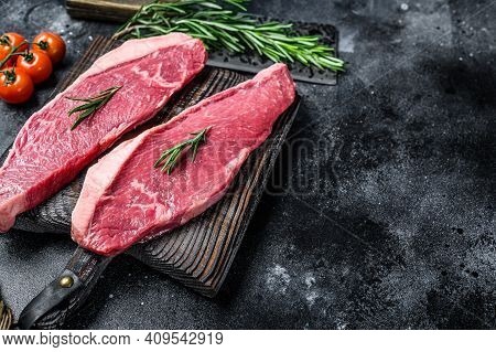 Raw Top Sirloin Cap Or Picanha Steak. Black Background. Top View. Copy Space