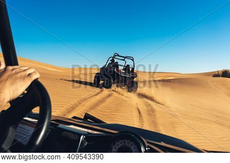 Dubai, Uae - 12.13.2014: View Of Steering Wheel And Desert Landscape From Driver Seat During Safari