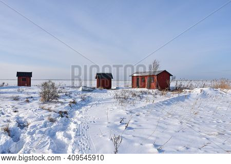 Red Fishing Sheds By The Coast On The Swedish Island Oland