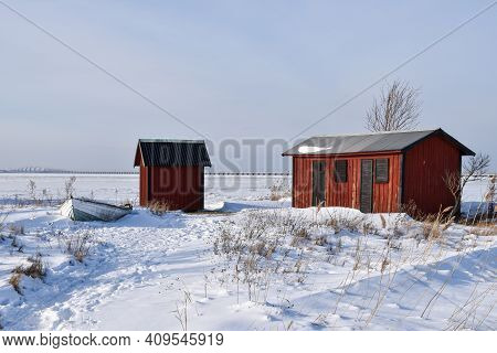 Red Fishing Sheds In Winter Season By The Coast Of The Baltic Sea At The Island Oland In Sweden