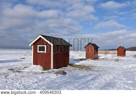 Red Small Fishing Cabins By The Coast Of The Island Oland In Sweden