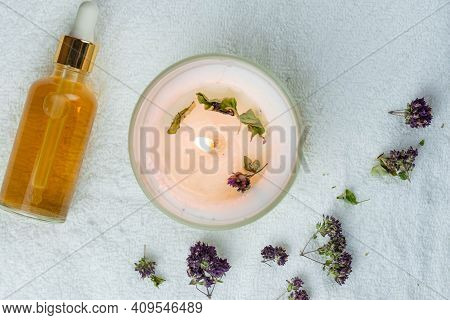 Herbal Therapy, Traditional Medicine And Homeopathy Concept. Towel With Salt, Herbs, Candles And Bot