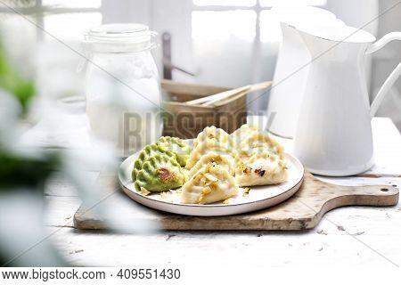 Dumplings, Pierogi With Chopped Fried Onion, On A White Plate.