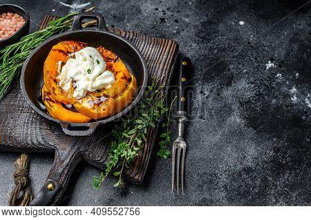 Cheese Mozzarella Burrata And Baked Pumpkin Salad. Black Background. Top View. Copy Space
