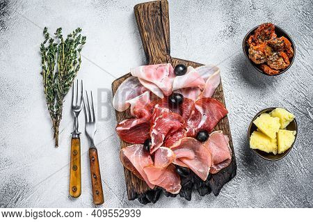 Cured Meat Platter Of Traditional Spanish Tapas. White Background. Top View
