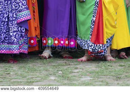 Colourful Drapes Of Sari, Traditional Indian Dress. Young Bengali Dancers Awaiting Their Turn To Enj