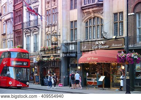 London, Uk - July 12, 2019: People Walk By Pubs And Cafes In Whitehall Area Of City Of Westminster,