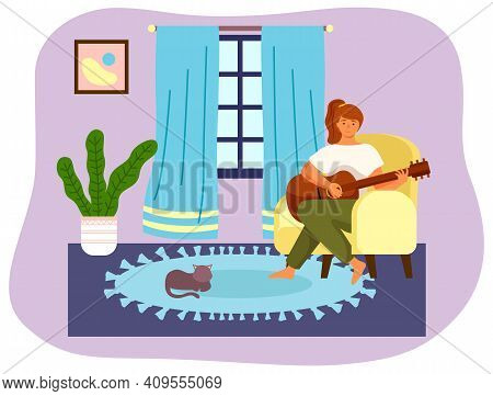 Woman Is Playing Guitar Sitting In Armchair. Musician Composes Songs And Sings At Home. Female Chara