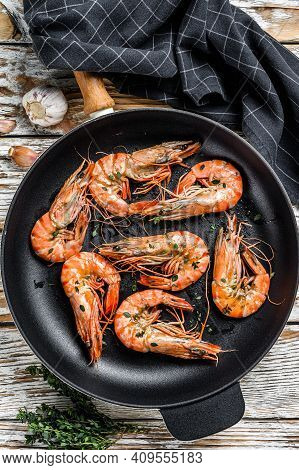 Grilled Tiger Shrimps Prawns With And Lemon In A Pan. White Wooden Background. Top View