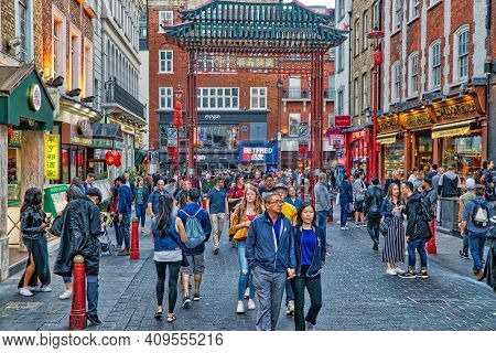 London, Uk - July 14, 2019: People Visit Chinatown District Of London, Uk. There Is A Minority Of 43