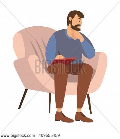 Bearded Man Is Sitting On A Chair And Writing In Notebook. Psychotherapist With Notepad In Hand Writ