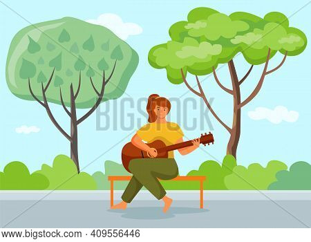 Woman Is Playing The Guitar Sitting On The Bench. The Musician In City Park With Natural Landscape.