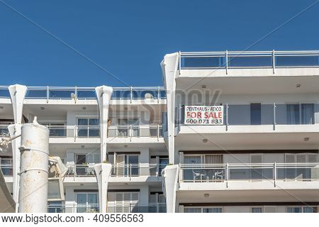Palmanova, Spain; February 20 2021: Facade Of A Tourist Apartment Building Empty Of Tourists And Wit