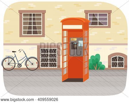 Empty London Red Classic Telephone Booth With An Open Door On The Street With A Bicycle At The Build