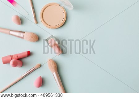 Makeup Products And Decorative Cosmetics On Blue Background. Beauty And Fashion Concept. Flat Lay, T