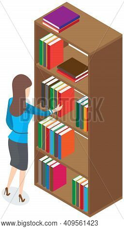 Beautiful Brunette Librarian Woman In Library Chooses Books On Shelves In Bookcase Back View. Young