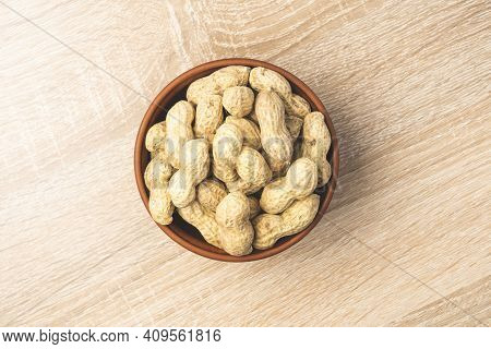 Peanuts In A Shell In A Clay Plate, Organic Peanuts Isolated On A White Background Top View. A Bunch