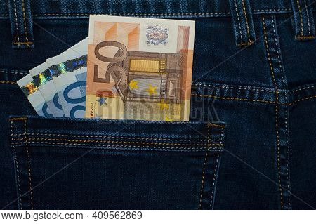 Money In Your Pocket. Euro Bills Of Different Denominations In The Back Pocket Of Jeans. The Concept