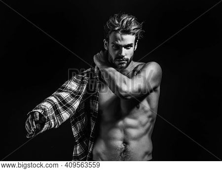 Sexy Young Handsome Naked Man With Messy Hair, Wears Plaid Shirt On Dark Background. Seductive Gay