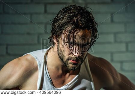 Sexy Man With Wet Hair In Singlet. Muscular Shoulders. Masculinity, Power And Strength