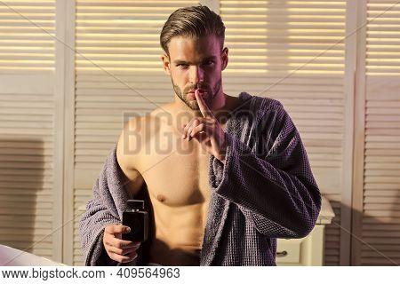 Fashion Sexy Man Show Silence Finger Gesture, Secret In Bathroom. Fashion, Perfume Spray