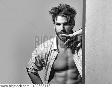 Handsome Man, Muscular Macho In Unbutton Shirt Points To Six Packs On Muscle Torso