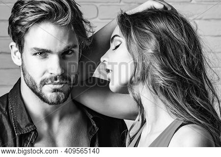 Sexy Couple Face. Young Beautiful Cute Lovers In Love White Brick Wall Background