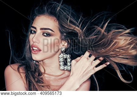 Sexy Girl With Makeup, Mascara, Wears Earrings Jewelry, Black Background. Woman With Long Hair And S