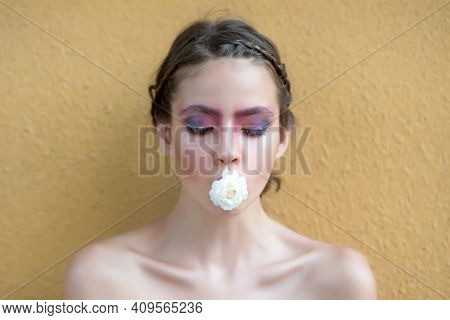 Spring Teen Woman With Flower In Mouth. Beauty, Nature Concept. Fashion Look, Makeup. Youth, Floweri