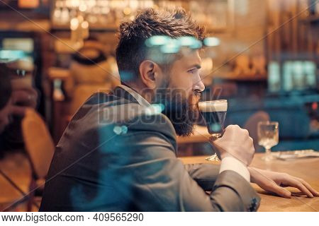 Alone Man Rest In Restaurant. Businessman With Long Beard Drink In Club. Serious Customer Sit In Caf
