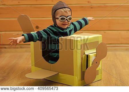 Kid Pilot Travel, Imagination. Little Boy Child Play In Cardboard Plane. Kids Ambition. Dream And Ad