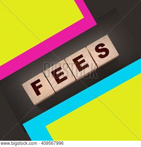 Wooden Blocks With The Word Fees . Taxes And Fees Business Concept.
