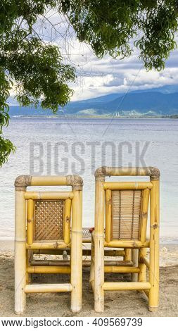 Specific Indonesian Beach Chairs On The Ocean.