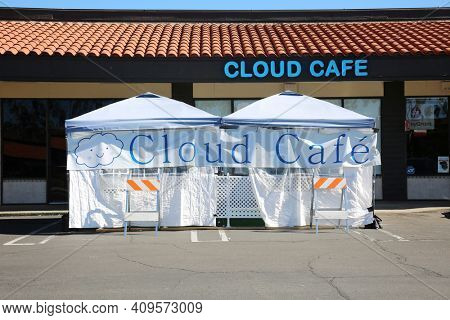 Lake Forest, California - USA - February 22, 2021: Outdoor Restaurant Dining. Restaurants are forced to set up outside tents and enclosures for dining due to the Coronavirus Pandemic Restrictions.