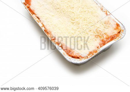 The Semifinished Lasagne In The Aluminium Tub Isolated On A White Background. The Fast Ready To Cook
