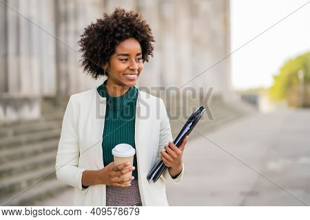 Portrait Of Afro Businesswoman Holding A Cup