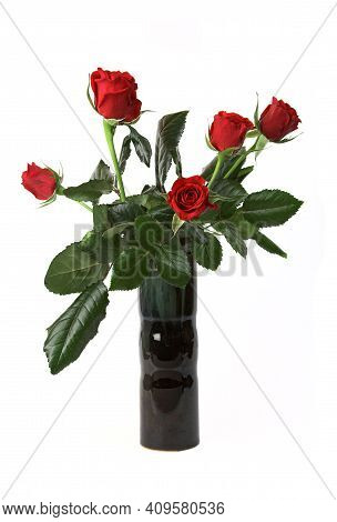 Red Roses In A Vase, Isolated Over White Background.