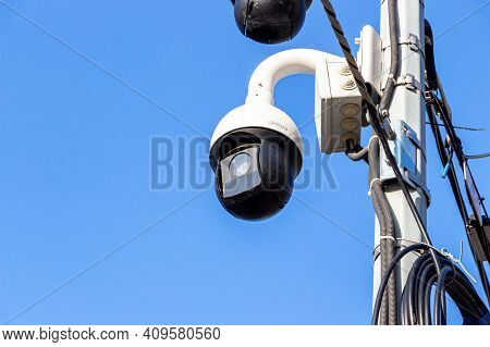 Samara, Russia - October 29, 2020: Surveillance Cctv Cameras Mounted On Post Against The Blue Sky