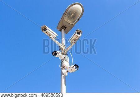 Samara, Russia - September 3, 2017: Surveillance Cctv Cameras Mounted On Post Against The Blue Sky