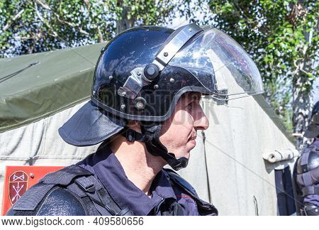 Samara, Russia - October 9, 2017: Special Forces Soldier In Protective Helmet With Glasses And Polic