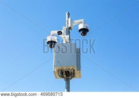 Samara, Russia - June 17, 2018: Surveillance Cctv Cameras Mounted On Post Against The Blue Sky