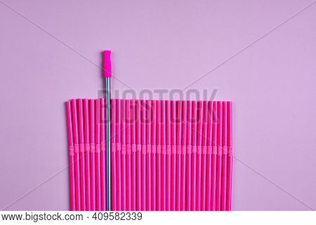 The Modern Trend Towards Caring For The Environment. Reusable Metal Beverage Straw Amongst A Pack Of