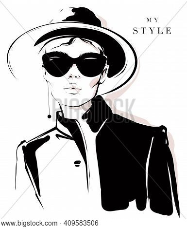 Fashion Girl In Black And White Style. Fashion Woman In Black Sunglasses. Stylish Woman In Black Hat