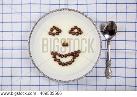 A Top View Of A Bowl Of Porridge And Images Of The Mouth, Eyes, And Nose Laid Out In White Brown Bal